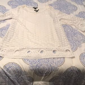 White lace blouse with bell sleeves